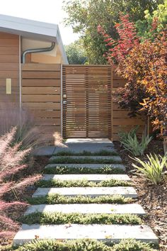 What a beautiful modern wooden gate with varied width boards. This is overkill for my scenario because of the front-facing lock and doorbell, but the rest of the details are fantastic. #modern wooden fence gate inspiration via www.L-2-Design.com