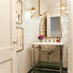 Lilly Bunn Interior | dalmatian wallpaper | gold rectangular mirror | polished chrome washstand | naked legs | antique brass sconce | staggered floor | gray slate tile floor | with a touch of pink