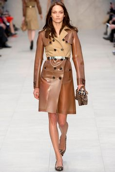 Burberry Prorsum fall 2013 - The trench coat constructed with rainwear fabrics, and also come with a metal belt.