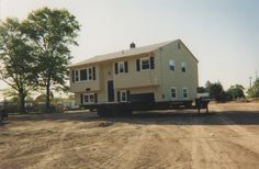 Don't let new development knock your house down, move it instead! This house was moved in New Brunswick, NJ to make way for a new street and new housing. Building Movers, Building Companies, South Amboy, House Lift, Raised House, House Movers, Flood Damage, Make Way, Home Safes