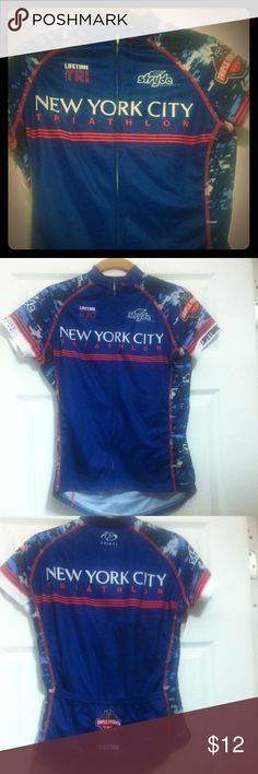 Reduced2014 NYC TRIATHLON Cycling Jersey Cycling jersey from the NYC Triathlon on 08-03-14 worn once as official merchandise vendor. Women's jersey size S. Slight pull in front as pictured.  Event sponsor logos. Three pockets in back to secure items while cycling. Posh rules please. Thanks for looking! Primal Tops