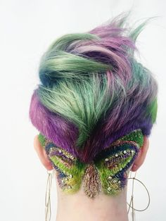 Party in the front, an even bigger party in the back! Presley Poe, Pravana artistic educator says she's a big believer in glitter, which is what inspired her to create this look in conjunction with Vivids. Customized creative color formulas, an undercut and a sparkle of shimmer created the perfect marriage, resulting in a colorful, whimsical look.