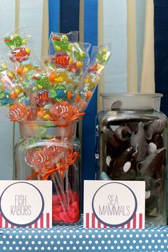 Gummy fish kababs and shark toys in a jar - from http://cupkatesandparties.blogspot.com/2010/11/under-sea-birthday-bash.html