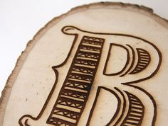 Great Wood Burned Initial Project made using a Walnut Hollow Basswood Country Round and wood burning tool.