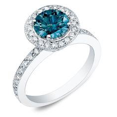 <li>Round-cut blue diamond engagement ring</li><li>14-karat gold jewelry</li><li><a href='http://www.overstock.com/downloads/pdf/2010_RingSizing.pdf'><span class='links'>Click here for ring sizing guide</span></a></li>