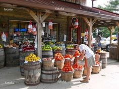 Maybe have a side yard or something where a farmer's market type deal can be set up so people can get fresh produce and cute nicknacks Farmers Market Display, Market Displays, Produce Market, Produce Displays, Produce Stand, Fruit Displays, Old General Stores, Old Country Stores, Country Farm