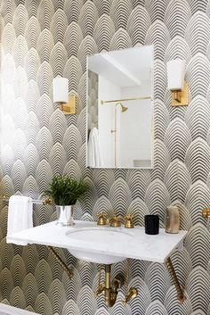 Powder room with black and white Art Deco wallpaper.