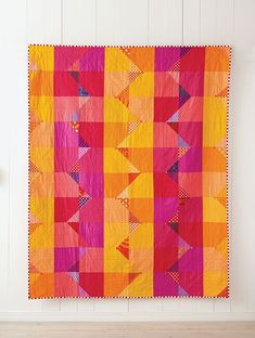Summer is a versatile quilt that can be  made as simple or as complex as you  like. The corner triangles add detail, so  you can add as few or as many as you  like—or leave them off entirely. Using bold color choices can make even the simplest designs sing, so have fun picking out your fabrics.