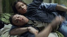 Sam and Dean wrestling. (I adore the looks of fear on their faces as they fall off the bed...)  (GIF)