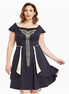 "If you're gonna be the HBIC at MACUSA, you gotta have a really awesome dress to match. The navy jacquard shines with a gold metallic MACUSA logo that's been detailed with embroidery. The hi-lo overlay gleams with gold lining, while the off shoulder sleeves are magic with a faux button back.<div><br></div><div><b>Model is 5'9.5"", size 1 <br></b><div><ul><li style=""list-style-position: inside !important; list-style-type: disc !important"">Size 14 measures 42 1/2"" from shoulder<..."