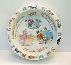 Antique German Baby dish Nursery Rhymes - I have one of these that was my mama's.  It's accented with gold leaf.