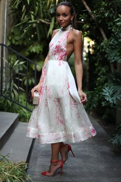Ashley Madekwe wearing a Zimmermann dress, Louboutin shoes, Sutra earring and Edie Parker clutch