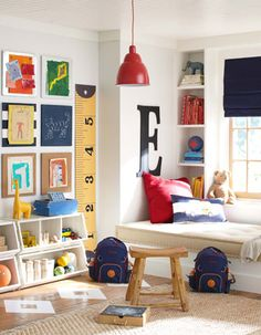 Several cute ideas for a little boy room: window framed with bookshelves and window seat, giant letter, fun toy storage