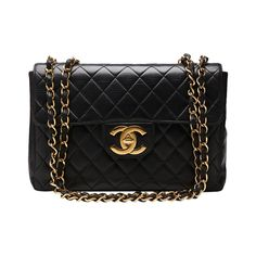 1990s Chanel Black Quilted Lambskin Jumbo XL Flap Bag   From a collection of rare vintage shoulder bags at https://www.1stdibs.com/fashion/handbags-purses-bags/shoulder-bags/