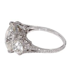 Antique Old Mine Cushion Cut Diamond Platinum Ring | From a unique collection of vintage three-stone rings at https://www.1stdibs.com/jewelry/rings/three-stone-rings/