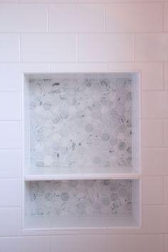 built-in shampoo shelf in shower