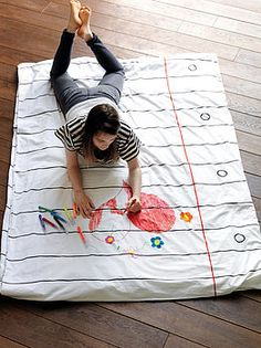 Use shower curtain liner, permanent markers.. and then kids write with dry/wet erase markers. What?? How cool is this!