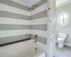 Shower With Gray Subway Tiles - Design photos, ideas and inspiration. Amazing gallery of interior design and decorating ideas of Shower With Gray Subway Tiles in bathrooms, laundry/mudrooms, kitchens by elite interior designers. Gray Shower Tile, Small Bathroom, Striped Tile, Bathroom Inspiration, Boys Bathroom, Bathrooms Remodel, Shower Design, Tile Design, Farmhouse Shower