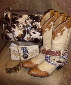 All decked out cowgirlie style in cowprint and crystal cross handbags, vintage cowgirl boots, belts with bling, jewels to adorn and fantastic accessories!