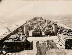 Seabee Construction Battalion Detachment 1006 crossing the Mediterranean onboard LST 388 supporting the Sicilian Invasion. Causeways that aided the troops ashore can be seen as they are strapped alongside the LST. Ww2 Photos, Show Photos, United States Navy, Historical Images, D Day, Normandy, North Africa, Sicily, World War Ii
