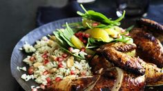 Pomegranate glazed chicken with herb pilaf.