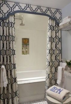 DIY DECOR TIP:: (two shower curtains and a valence makes a boring bathtub elegant !!!). .