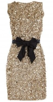 Gold sequinned dress with black bow belt