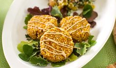 Raw Carrot Falafel::   Yield: 4 servings/  1 cup sesame seeds 1⁄2 teaspoon sea salt 1 1⁄2 cups carrot pulp from juicing or 1 1⁄2 cups finely grated carrot, squeezed firmly between paper towels to remove excess moisture 2 cloves garlic, minced 1 tablespoon freshly squeezed lemon juice 1⁄4 teaspoon ground cumin (optional) 2 tablespoons flax meal 1⁄4 cup fresh curly parsley