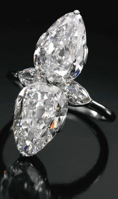 Diamond ring, Cartier, 1930s set with two pear-shaped diamonds weighing 2.31 and 2.34 carats respectively, further accented with two marquise-shaped diamonds,  signed Cartier London, case stamped Cartier Paris.