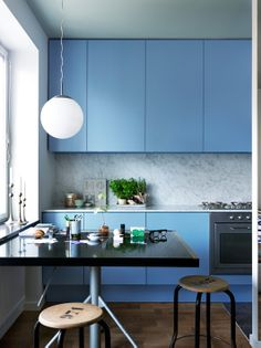 J. Ingerstedt - Interior photography. Love the use of colour in the cabinetry and how it's grounded by the marble