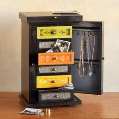 Our biggest jewelry bureau yet, a Sundance exclusive in stained wood with storage space galore.