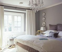 I wouldn't mind waking up in this bedroom every morning, especially with that chandelier.