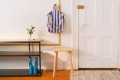You don't need massive square footage to create the organized entryway of your dreams.