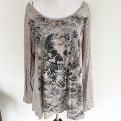 Rock & Republic Skull Shirt Size XL. Light lint pilling (see photos) Only worn a couple of times. No rips or stains. Great condition. Rock & Republic Tops