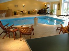 Decorating, Small Indoor Swimming Pool Designs With Wood Sofas And Chairs Also Wall Lighting Ideas: The Best of Luxury Indoor Swimming Pools...