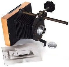 Photographer Chuck Baker turned one of his old 35mm film enlargers into a working large format camera.