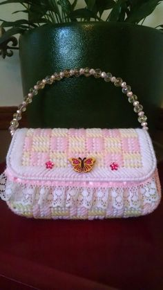 Butterfly plastic canvas purse designed by Kathy Holtz