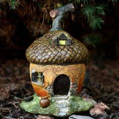 Acorn Fairy House. www.teeliesfairygarden.com . . . Turn your garden into a place where enchanted little creatures are welcome to stay with this adorable acorn fairy house! #fairyhouse