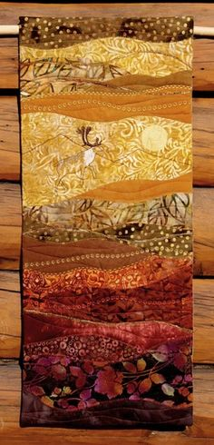 Tundra Caribou.  I love the colors and image of this quilt.  I'm not big on wall hanging quilts, but on a larger snuggly-sized quilt, this would be pretty gorgeous.  Beautiful work.