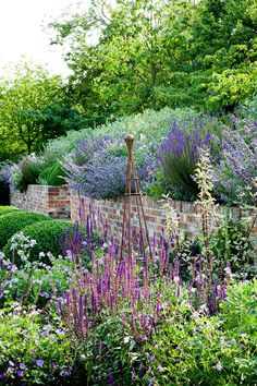English country garden ideas - Invest in an Iron Obelisk – in Country Garden Design Ideas – how to a create a well-planned herbaceous border and farmhouse or cottage look, ideas for gardens both big and small. Back Gardens, Outdoor Gardens, Garden Ideas For Large Gardens, Small Country Garden Ideas, Amazing Gardens, Beautiful Gardens, Cottage Garden Design, English Garden Design, Garden Design Ideas