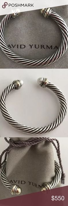 David Yurman 7mm Silver and Gold Cable Bracelet David Yurman 7mm Sterling Silver Classic Cable Bracelet with 18K gold tips. This is an iconic David Yurman piece, very hard to find, and in EXCELLENT condition . Feel free to ask me questions! No trades on this item. David Yurman Jewelry Bracelets