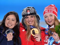 Sochi 2014 Day 13 - Medal Ceremony Silver medalist Tomoka Takeuchi of Japan, gold medalist Patrizia Kummer of Switzerland and bronze medalist Alena Zavarzina of Russia celebrate on the podium during the medal ceremony for the Women's Parallel Giant Slalom on day 13 of the Sochi 2014 Winter Olympics at at Medals Plaza