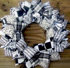 Sheet Music Fabric Wreath ~ Whether you're a student who plays an instrument, or teach band at any level, this is the music wreath you want to dress up your classroom, dorm, bedroom wall or front door! Black and white coordinating fabrics filled with sheet music and instruments such as guitar, violin, horns, in black & white, black & white checks and a gorgeous black & white plaid help bring this music themed wreath to its full glory.  $34.00  @Artfire.com.com.com Music Studio Decor, Music Decor, Fabric Wreath, Burlap Wreath, Door Wreath, Music Crafts, Hobbies And Crafts, Best Christmas Gifts, Christmas Fun