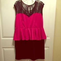 Hot Pink Lace Peplum Dress Super cute hot pink and black lace peplum dress. Perfect for a night on the town! One small hole in the top of the right shoulder. Price reflects. Delirious Dresses Midi