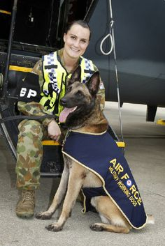 Military Working Dog Handler Lauren Marshall with her dog Jeep on the flightline at RAAF Base Richmond.