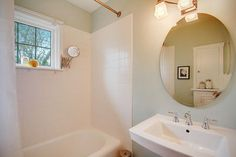 good idea; install window in upstairs showed and add accordian mirror. No more suction cup mirror crashing down in the night! Hawthorne Hills Area Residential: Bathroom