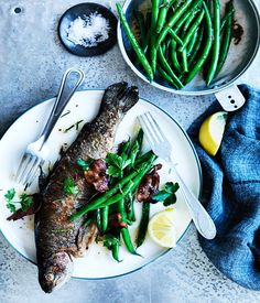 This buttery rainbow trout recipe is full of summer flavour with fresh lemons, almonds, bacon and rosemary. Use the best smoked streaky bacon you can find to take this dish to the next level.