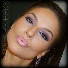 Purple makeup. Follow @beautybybeks for details