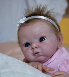 this ugly, fake baby costs 2600 pounds. why do people go on ebay to buy these scary fake babies?!