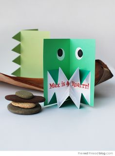 the red thread pop up origami dinosaur invite by http://www.theredthreadblog.com/make-it-pop-up-origami-dinosaur-invitations